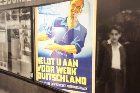 AMSTERDAM, NETHERLANDS - DEC 11, 2018 - German propaganda posters for Netherlands, World War II Resistance Museum, Amsterdam, Netherlands
