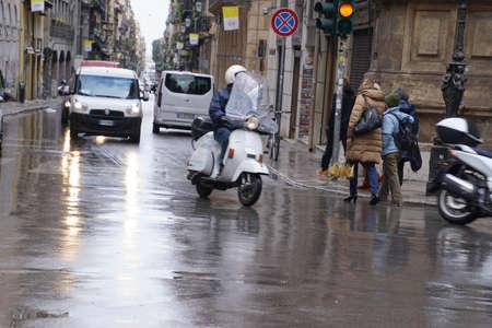 PALERMO, SICILY - NOV 28, 2018 - Motorcycle on rain slick street in Palermo, Sicily, Italy Editorial