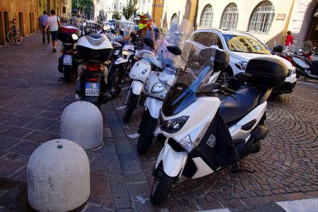 BOLZANO, ITALY - JUL 26, 2018 - Vespa motorbikes parked in the old city of Bolzano, Italy