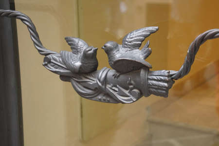 Birds on metal door handle in Taormina Sicily, Italy Stock Photo