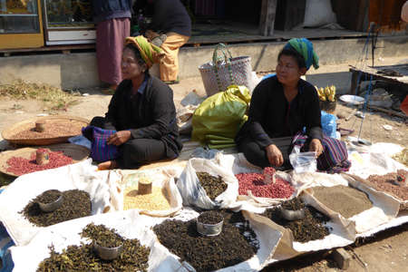 INLE LAKE, MYANMAR - MAR 1, 2015 - Woman selling beans at the weekly market on  Inle Lake,  Myanmar (Burma)