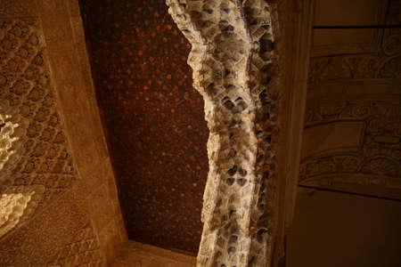 GRENADA, SPAIN - NOV 23, 2018 - Stalactite modeling on ceiling strut of the Alhambra Palace, Grenada, Spain