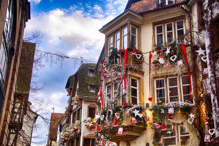 STRASBOURG, FRANCE - DEC 20, 2018 - Decorations on the buildings along street in Christmas market,Strasbourg, France Editorial