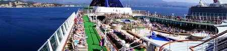 AJACCIO, CORSICA - APR 24, 2018 - Panorama of the pool deck of a cruise ship anchored in Ajaccio Corsica, France