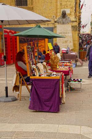 VALLETTA, MALTA - APR 12, 2018 - Jewelry stalls in a plaza of Valletta, Malta