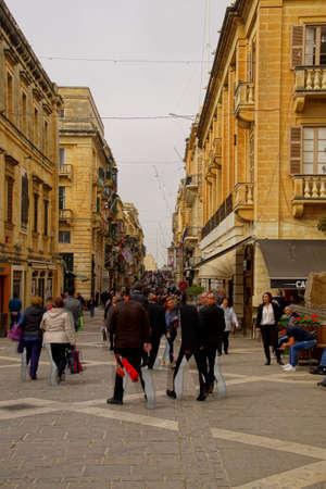 VALLETTA, MALTA - APR 12, 2018 - Walkers on main street of Valletta, Malta
