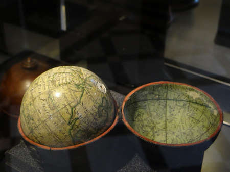 GENEVA, SWITZERLAND - FEB 24, 2018 - Vintage globes of earth at the History of Science Museum in Geneva, Switzerland