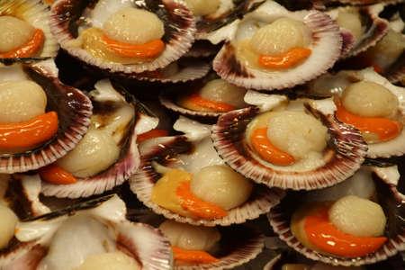 Fresh scallops at a fish stall in Mercado de Atarazanas (Shipyard market ) Malaga, Spain