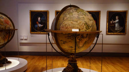 MUNICH - JUL 22, 2018 - Large antique globes showing the world and celestial zodiac stars, Bavarian National Museum, Munich, Germany
