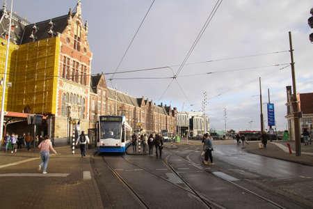 AMSTERDAM, NETHERLANDS - DEC 11, 2018 - Blue tram near the Centraal Railroad Station in Amsterdam, Netherlands