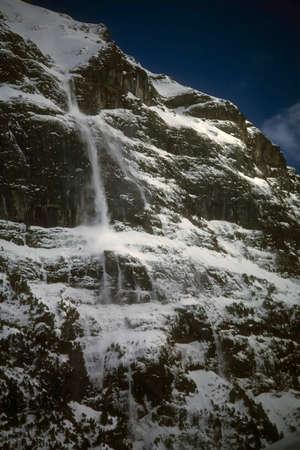 Avalanche  on steep mountain face,GrindelwaldSwitzerland Stock Photo