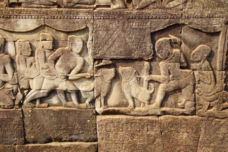 Warriors marching  into battle, detail of bas relief sculpture in  Bayon, Angkor Thom,  Siem Reap, Cambodia