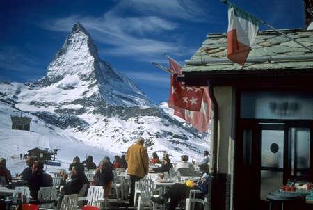 ZERMATT, SWITZERLAND - FEB 20, 2000 - Lunch with a view of the Matterhorn, skiers, Riffelalp, ZermattSwitzerland Editorial
