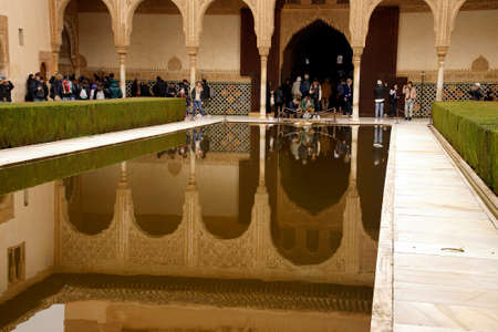 GRENADA, SPAIN - NOV 23, 2018 - Arabic style buidng and interior garden with reflecting pool in the Alhambra Palace, Grenada, Spain Editorial