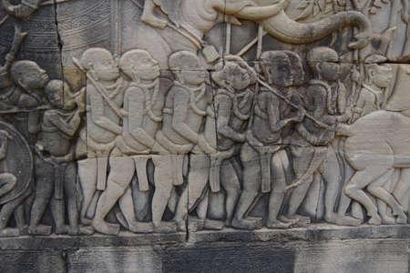 Elephant follows a procession of slaves,  Bayon, Angkor Thom,  Siem Reap, Cambodia Foto de archivo