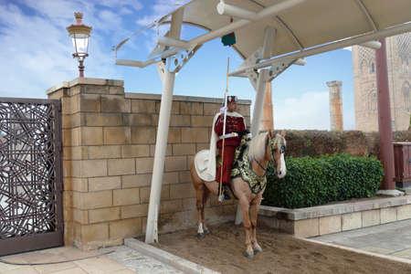 RABAT, MOROCCO - FEB 12, 2019 - Mounted guard in traditional uniform, Mausoleum of  Mohammad V, Rabat, Morocco Editorial