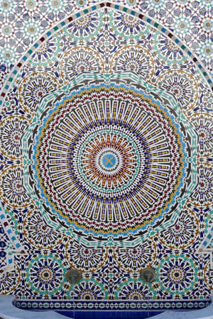 FES, MOROCCO - FEB 13, 2019 - Beautiful infinity desgn mosaic fountain, Artisanal pottery workshop, Fes, Morocco