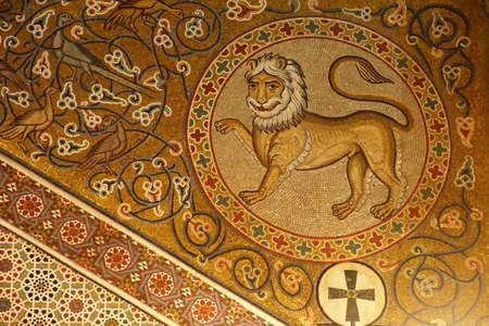PALERMO, SICILY - NOV 28, 2018 - Lion mosaic on wall of the Capella Palatina, Palermo, Sicily, Italy