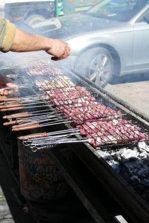 Skewers of beef on open BBQ grill in Zaida, Morocco Фото со стока