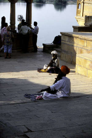 RAJASTHAN, INDIA - NOV 3,, 2003 - Musicians play on traditional instruments at a temple in Jaisalmer, Rajasthan in India Editorial