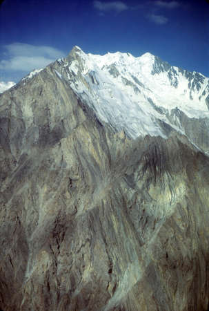 Steep mountain peak and glacier in the Pamirs, former USSR, now border of Tajikistan and Kyrgyzstan, near Afghanistan