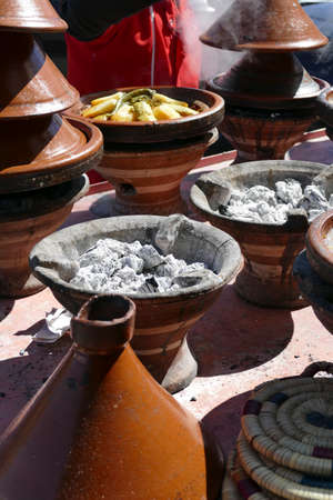 Vegetables steaming in tagine cooking pots in Zaida, Morocco, Africa Standard-Bild - 118558878