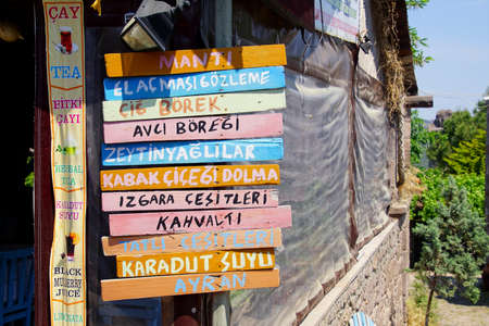 ASSOS, TURKEY - MAY 1, 2018 - Signs for local boutique hotels in Behramkale Assos, Turkey