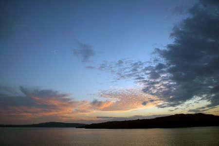 Sunset over the caldera crater of Santorini, Greece Фото со стока