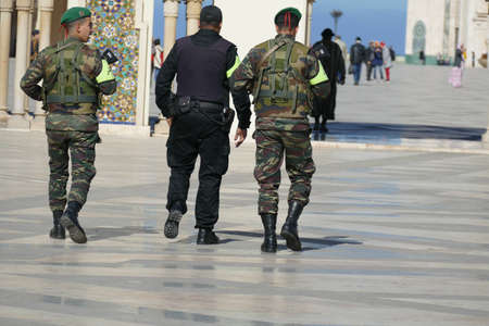 CASABLANCA, MOROCCO - FEB 11, 2019 - Security guards with automatic weapons at the  Hassan II mosque, Rabat, Morocco, Africa