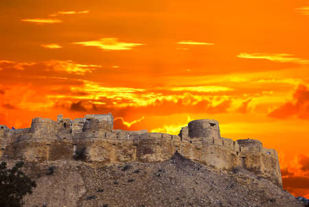 Sunset over city fortress walls of Jaisalmer, India Stock Photo
