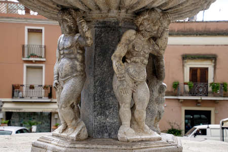 TAORMINA, SICILY - NOV 29, 2018 - Cherubs holding up a fountain in Taormina, Sicily, Italy 스톡 콘텐츠