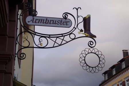 GEGENBACH, GERMANY - DEC 20, 2018 - Iron shop signs along the main street of  Gegenbach, Germany