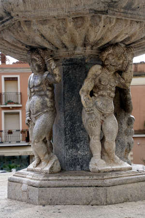 TAORMINA, SICILY - NOV 29, 2018 - Cherubs holding up a fountain in Taormina, Sicily, Italy Stock Photo
