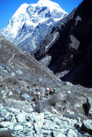 Porters carrying loads in the  Langtang Valley,Langtang Himal, Himalayas, Nepal, Asia Stock Photo
