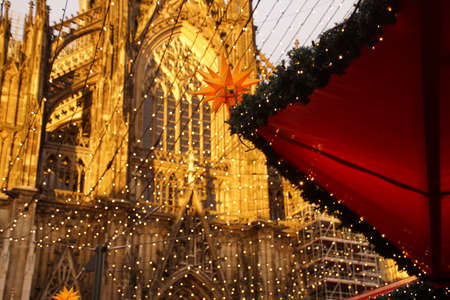 Cathedral background to the decorations and lights of the Christmas market,Cologne, Germany Reklamní fotografie