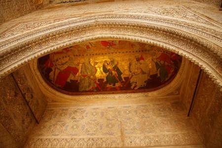 GRENADA, SPAIN - NOV 23, 2018 - Gilt fresco of court life in Alhambra Palace, Grenada, Spain