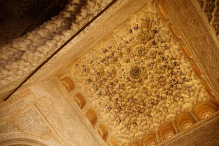 GRENADA, SPAIN - NOV 23, 2018 - Stalactite modeling on ceiling and struts of the Alhambra Palace, Grenada, Spain Editorial