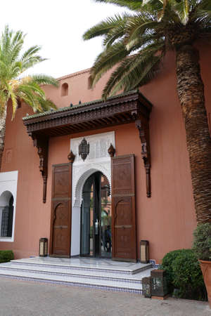 MARRAKECH, MOROCCO - FEB 18, 2019 - Large ornate doors of a luxury hotel, Royal Mansour, Marrakech,  Morocco, Africa