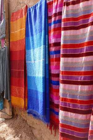 Bright colored carpets outside a shop near the hilltop village of Ait ben Haddou,  Morocco, Africa Standard-Bild - 120704697
