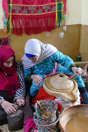 MARRAKECH, MOROCCO - FEB 17, 2019 - Local women extract oil from argan nuts in the High Atlas mountains outside Marrakech,  Morocco, Africa