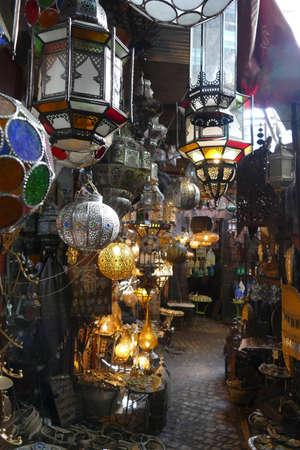 MARRAKECH, MOROCCO - FEB 18, 2019 - Filigree metal lamps in a shop in the medina bazaar of Marrakech,  Morocco, Africa