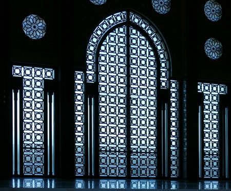 CASABLANCA, MOROCCO - FEB 11, 2019 - Intricate lattice work windows and doors of the Hassan II mosque, Casablanca, Morocco