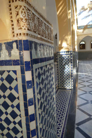 RISSANI, MOROCCO - FEB 15, 2019 - Mosaic tiled columns in the Moulay Ali Cherif Mausoleum,  Rissani, Morocco, Africa 에디토리얼