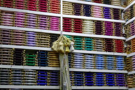 Multi - colored threads on shelves in a shop of the medina of Fes, Morocco, Africa