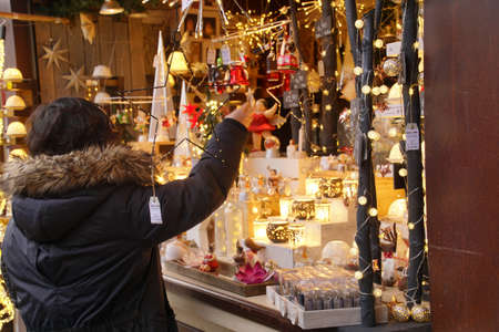 COLOGNE, GERMANY - DEC 17, 2018 - Visitors explore the small craft shops set up in the Christmas market,Cologne, Germany Editöryel