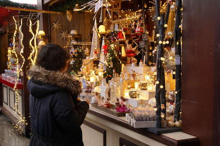 COLOGNE, GERMANY - DEC 17, 2018 - Visitors explore the small craft shops set up in the Christmas market,Cologne, Germany Reklamní fotografie - 120528240