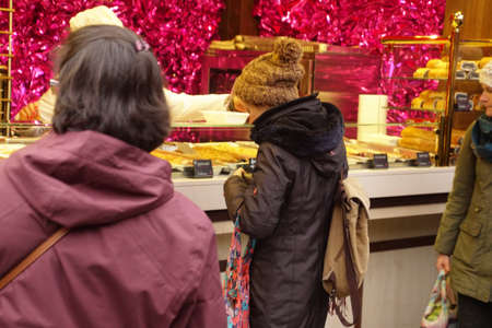 COLOGNE, GERMANY - DEC 17, 2018 - Sampling the food at the Christmas market,Cologne, Germany Stok Fotoğraf - 120528360