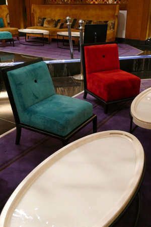 MARRAKECH, MOROCCO - FEB 18, 2019 - Primary colored chairs in lobby of Movenpick Hotel, Marrakech,  Morocco, Africa Imagens - 120528364