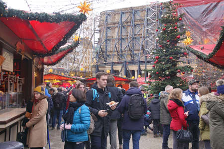 COLOGNE, GERMANY - DEC 17, 2018 - Sampling the food at the Christmas market,Cologne, Germany Stok Fotoğraf - 120454184