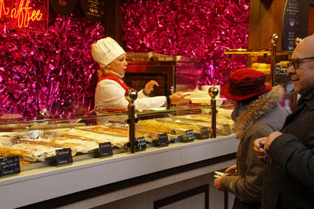 COLOGNE, GERMANY - DEC 17, 2018 - Sampling the food at the Christmas market,Cologne, Germany Stok Fotoğraf - 120454132